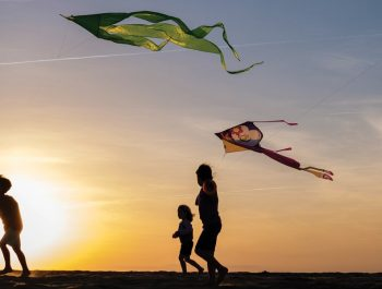 kids with kites at sunset on Jockey's Ridge